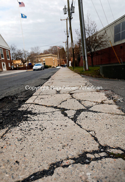 Seymour, CT- 18 December 2015-121815CM01-  A cracked sidewalk is shown along Deforest Street in Seymour on Friday.  Seymour resident, Joseph Luciano has complained to the town about the accessibility of the sidewalks.      Christopher Massa Republican-American