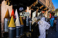 Morocco. Marrakesh medina in the area known as Kasbah. Two women in front of a spice shop.