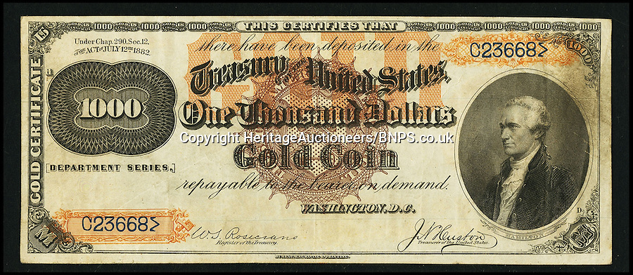 """BNPS.co.uk (01202) 558833<br /> Picture: HeritageAuctioneers<br /> <br /> 1882 $1000 Gold Large Brown Seal - front<br /> <br /> Four rare bank notes once deemed worthless are set to sell for a staggering £3.5 million after they were discovered in a drawer. The notes, totalling 3,500 US dollars, are so rare that experts feared them lost forever - and have hailed their discovery as a """"trophy find"""". They date back to the 1880s and have miraculously survived the last 130 years in tact after being kept in a drawer at the home of a US banker. The currency - three 1,000 dollar notes and one 500 dollar note - are now tipped to sell for 1,700 times their face value."""