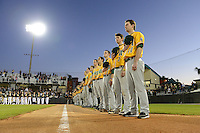Siena Saints coach Elliot Glynn (44), infielder Brett Connors (2), pitcher Justin Scala (5), infielder Yahriel Jimenez (7), outfielder Mike Williams (9) during the national anthem before the season opening game against the Central Florida Knights at Jay Bergman Field on February 14, 2014 in Orlando, Florida.  UCF defeated Siena 8-1.  (Mike Janes/Four Seam Images)