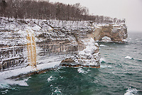 Jon Jugenheimer on an open water lead climb of HMR an ice climb on Lake Superior at Pictured Rocks National Lakeshore near Munising, Michigan.