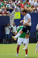 Kyle Beckerman (5) of the United States (USA) heads the ball. Mexico (MEX) defeated the United States (USA) 5-0 during the finals of the CONCACAF Gold Cup at Giants Stadium in East Rutherford, NJ, on July 26, 2009.