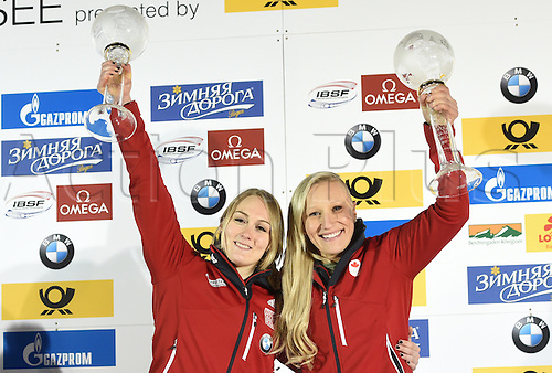 26.02.2016. Koenigssee,  Berchtesgaden, Germany.  Canadian Bobsleigh pilots Kaillie Humphries (r) and Melissa Lotholz holding up their trophies for the World Cup victory at the 2-women Bobsleigh World Cup at Koenigssee