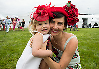 BALTIMORE, MD - MAY 20: A mother and her daughter pose for a photo in the infield on Preakness Stakes Day at Pimlico Race Course on May 20, 2017 in Baltimore, Maryland.(Photo by Jesse Caris/Eclipse Sportswire/Getty Images)