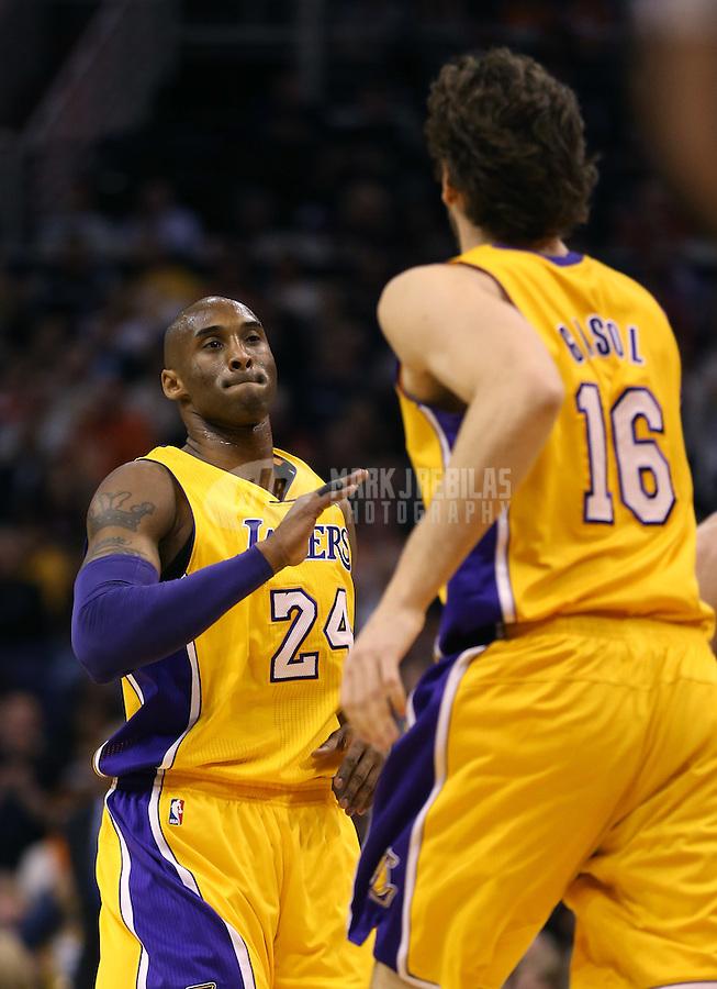 Jan. 30, 2013; Phoenix, AZ, USA: Los Angeles Lakers guard Kobe Bryant (24) celebrates a play with Pau Gasol against the Phoenix Suns at the US Airways Center. Mandatory Credit: Mark J. Rebilas-