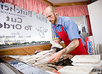 Russ Brown, the meat cutter, stacks meat in the morning at Elias' Butcher Shop in Roanoke Rapids, North Carolina.