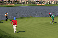 Thomas Aiken (RSA) and Chris Kirk (USA) on the 6th green during Sunday's Final Round of the 2014 BMW Masters held at Lake Malaren, Shanghai, China. 2nd November 2014.<br /> Picture: Eoin Clarke www.golffile.ie