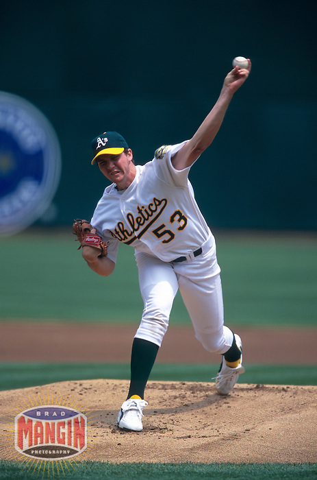 OAKLAND, CA:  Barry Zito of the Oakland Athletics in action at the Oakland Coliseum in Oakland, California in 2000. (Photo by Brad Mangin)