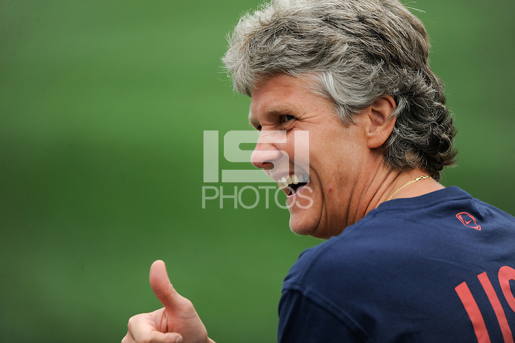 United States (USA) head coach Pia Sundhage gives the thumbs up to a fan after Abby Wambach (not pictured) scored her 100th career goal. The United States (USA) Women's National Team defeated Canada (CAN) 1-0 during an international friendly at Marina Auto Stadium in Rochester, NY, on July 19, 2009.