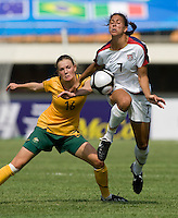 USWNT midfielder (7) Shannon Boxx is fouled by Australia's (16) Lauren Colthorpe during the Peace Queen Cup  in Suwon, South Korea.  The U.S. defeated Australia, 2-1, at the Suwon Sports Complex.