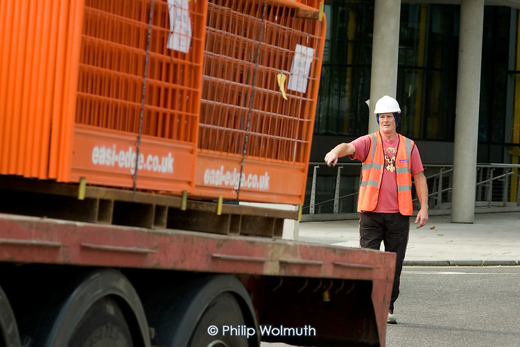 A construction worker at Market Square, part of the Paddington Waterside development at Paddington Basin.