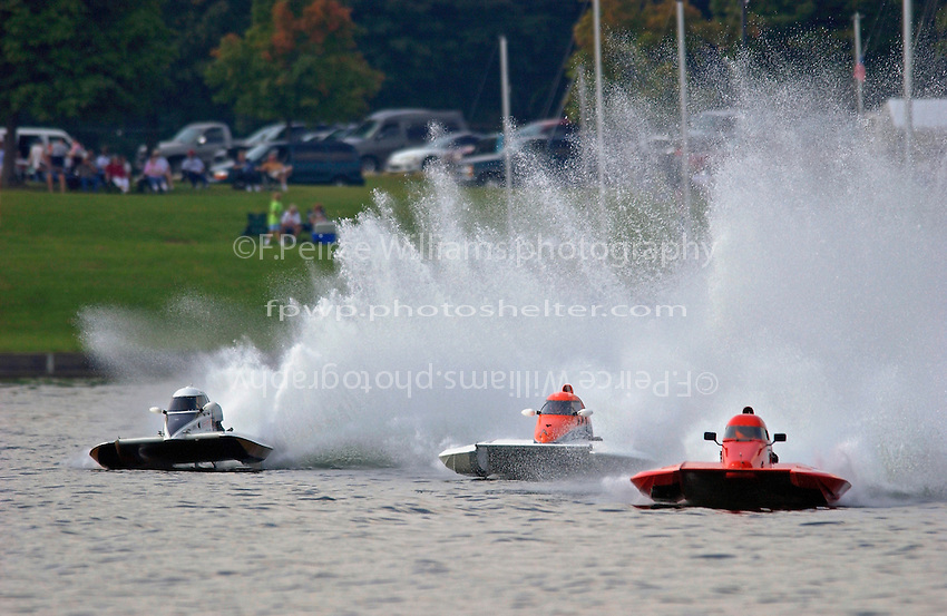 """(L to R):Robin Shane, T-14 """"Hijacker"""", Jimmy Shane, T-1  and """"Mystery Boat"""" (1 Litre Stock hydroplane(s)"""