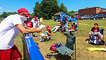 TORRINGTON, CT - 04 JULY 2020 - 070420JW03.jpg --  Torrington Little League Reds coach Matt Parkhouse reads off the positions for the team to play against the Brewers during opening day of play at Torrington Middle school's Colangelo Fields Saturday afternoon. Jonathan Wilcox Republican-American