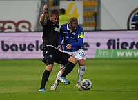 Fabian Holland (SV Darmstadt 98) gegen Lukas Grozurek (Karlsruher SC) - 04.10.2019: SV Darmstadt 98 vs. Karlsruher SC, Stadion am Boellenfalltor, 2. Bundesliga<br /> <br /> DISCLAIMER: <br /> DFL regulations prohibit any use of photographs as image sequences and/or quasi-video.