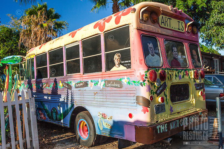 School bus painted  by Ron Artis at his outdoor art gallery in Haleiwa, O'ahu.