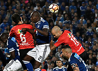 BOGOTA - COLOMBIA – 17 - 04 - 2018: Anier Figueroa (Cent.) jugador de Millonarios (COL), disputan el balon con David Mendoza (Izq.) y Ricardo Andreutti (Der.) jugadores de Deportivo Lara (VEN), durante partido entre Millonarios (COL) y Deportivo Lara (VEN), de la fase de grupos, grupo G, fecha 3 de la Copa Conmebol Libertadores 2018, en el estadio Nemesio Camacho El Campin, de la ciudad de Bogota. / Anier Figueroa (C) player of Millonarios (COL), fights for the ball with David Mendoza (L) and Ricardo Andreutti (R) players of Deportivo Lara (VEN), during a match between Millonarios (COL) and Deportivo Lara (VEN), of the group stage, group G, 3rd date for the Conmebol Copa Libertadores 2018 in the Nemesio Camacho El Campin stadium in Bogota city. VizzorImage / Luis Ramirez / Staff.