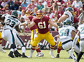 Washington Redskins center Spencer Long (61) blocks for Redskins quarterback Kirk Cousins (8) in third quarter action against the Washington Redskins at FedEx Field in Landover, Maryland on Sunday, September 10, 2017.  The Eagles won the game 30 - 17. <br /> Credit: Ron Sachs / CNP