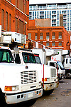 Lines of refrigerated trucks are backed up to the dock of a warehouse in the meat packing district of Chicago.