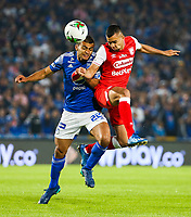 BOGOTA, COLOMBIA - MARCH 03: Edwin Herrera of Santa Fe fights for the ball with against John Duque of Millonarios during the match between Millonarios and Independiente Santa Fe as part of the Liga BetPlay at Estadio El Campin on March 3, 2020 in Bogota, Colombia. (Photo by John W. Vizcaino/VIEW press/Getty Images)