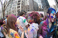 Colored powder is applied to the faces of participants as they celebrate the Indian holiday of Holi at a street festival in Dag Hammarskjold Plaza in New York on Sunday, March 31, 2013.  The spring holiday of Holi, also called Festival of Colors, is celebrated by throwing and wearing colored powder.  (© Richard B. Levine)