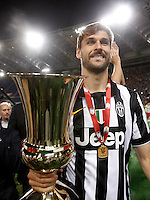 Calcio, finale Tim Cup: Juventus vs Lazio. Roma, stadio Olimpico, 20 maggio 2015.<br /> Juventus' Fernando Llorente holds the trophy at the end of the Italian Cup final football match between Juventus and Lazio at Rome's Olympic stadium, 20 May 2015. Juventus won 2-1 after extra time.<br /> UPDATE IMAGES PRESS/Isabella Bonotto