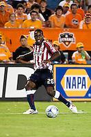Chivas USA forward Atiba Harris (20) strikes the ball.  Houston Dynamo defeated CD Chivas USA 1-0 at Robertson Stadium in Houston, TX on June 10, 2009.