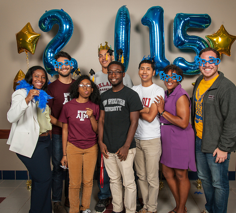 Students pose for a photograph during the Academic Signing Day event at the Region 4 Education Center, May 21, 2015.
