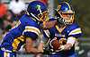 Matthew Sluka #10, Kellenberg quarterback, right, hands off to Jordan DeLucia #7 during a CHSAA varsity football game against Holy Trinity at Mitchel Athletic Complex in Uniondale on Sunday, Sept. 17, 2017. Kellenberg won by a score of 45-0.