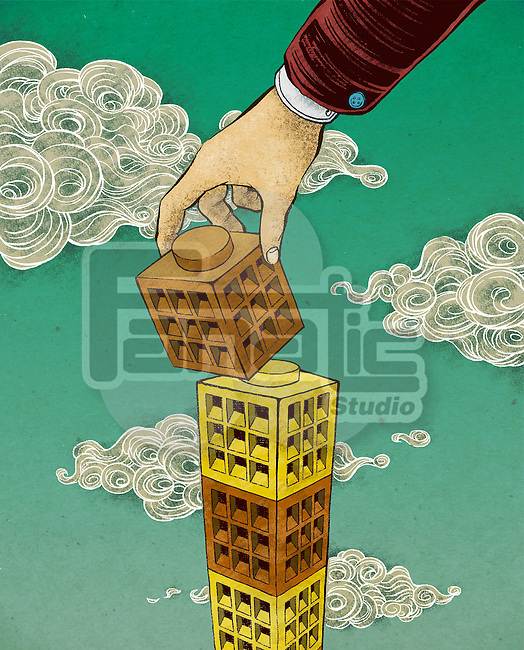 Conceptual shot of human hand positioning blocks depicting expansion of business