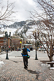 USA, Colorado, Aspen, a skier walks through downtown Aspen on his way to the mountain, Aspen Ski Resort, Ajax