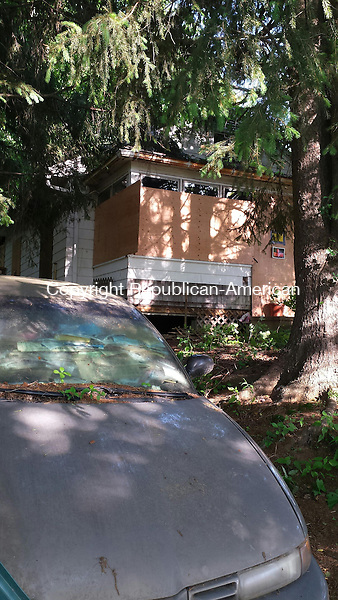 CHESHIRE, CT - June 15, 2014 - 06152014LX04 - A woman who lived in this home on Winslow Street may have died when the floor of her kitchen collapsed.