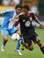 D.C. United forward Lionard Pajoy (26) shields the ball from Philadelphia Union defender Sheanon Williams (25) D.C. United tied The Philadelphia Union 1-1 at RFK Stadium, Saturday August 19, 2012.