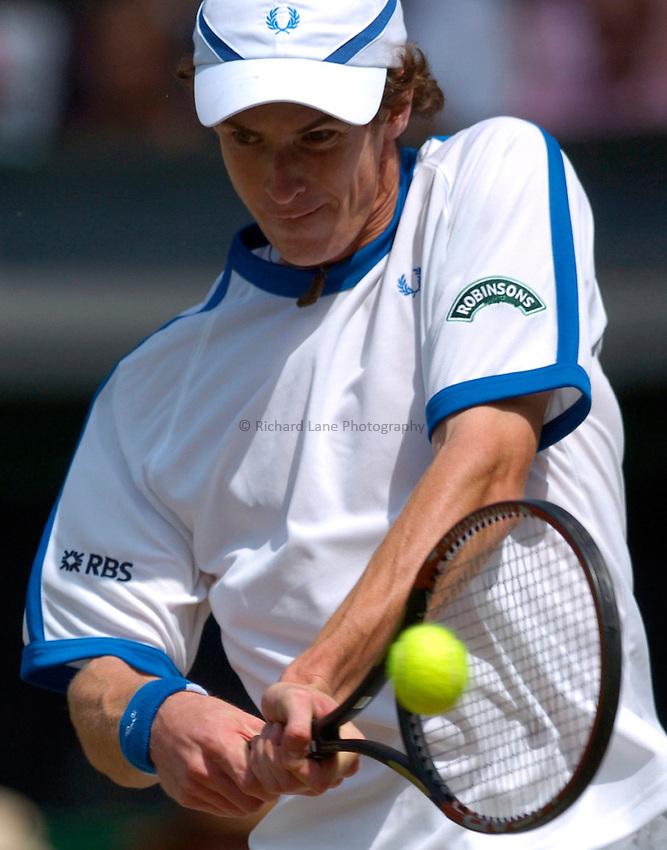 Photo: Richard Lane..Wimbledon Championships. 03/07/2006. .Great Britain's Andy Murray returns.