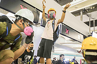 CHINA, Hong Kong: 21 August 2019 <br /> Demonstrators clash with riot police at Yuen Long Station this evening after the train station was filled with protesters angry about the Yuen Long attack which happened a month ago today.  <br /> The attack was by approximately 100 men who violently attacked protesters, reporters and a pregnant woman. No arrests were made and it is believed the gang were colluding with the police.<br /> Rick Findler / Story Picture Agency