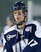 Jay Camper (UNH - 17) - The University of Maine Black Bears defeated the University of New Hampshire Wildcats 5-4 in overtime on Saturday, January 7, 2012, at Fenway Park in Boston, Massachusetts.