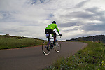 Man cycling in Red Rocks State Park, Colorado .  John leads private photo tours in Boulder and throughout Colorado. Year-round.