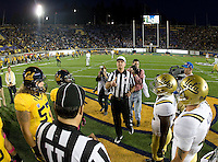 UCLA and California captains watch referee Terry Leyden toss the coin during coin toss ceremony before the game at Memorial Stadium in Berkeley, California on October 6th, 2012.  California defeated UCLA, 43-17.