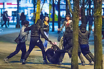© Joel Goodman - 07973 332324 . 07/04/2017 . Manchester , UK . 2nd in a sequence . Five youths on one as a fight breaks out in Piccadilly Gardens . Greater Manchester Police have authorised dispersal powers and say they will ban people from the city centre for 48 hours , this evening (7th April 2017) , in order to tackle alcohol and spice abuse . Photo credit : Joel Goodman