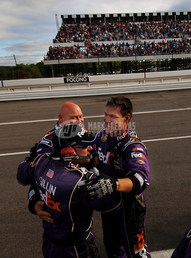 June 11, 2006; Long Pond, PA, USA; The crew of Nascar Nextel Cup driver Denny Hamlin (11) celebrate after winning the Pocono 500 at Pocono Raceway. Mandatory Credit: Mark J. Rebilas..