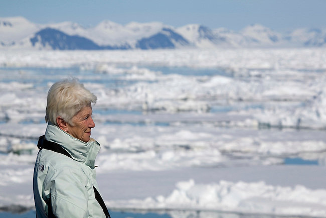 Stylish older woman enjoys an arctic adventure cruise to Spitsbergen