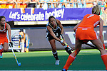 The Hague, Netherlands, June 12: Silvina D Elia #25 of Argentina passes the ball during the field hockey semi-final match (Women) between The Netherlands and Argentina on June 12, 2014 during the World Cup 2014 at Kyocera Stadium in The Hague, Netherlands. Final score 4-0 (3-0)  (Photo by Dirk Markgraf / www.265-images.com) *** Local caption ***