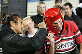 Tana Umaga signs the local bucket head after the game. ITM Cup rugby game between Counties Manukau and Manawatu played at Bayer Growers Stadium on Saturday August 21st 2010..Counties Manukau won 35 - 14 after leading 14 - 7 at halftime.