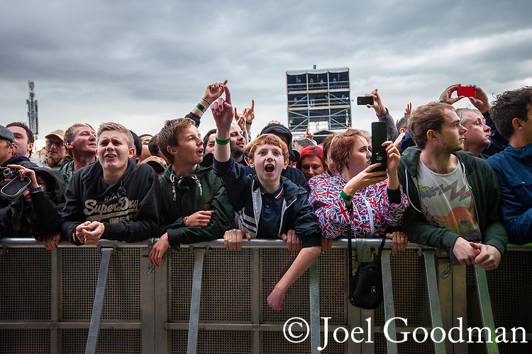© Joel Goodman - 07973 332324 . 30/06/2012 . Manchester , UK . Crowds watch as Beady Eye , fronted by Liam Gallagher , perform on stage ahead of the Stone Roses . Stone Roses Second Coming reunion gig at Heaton park in North Manchester . Photo credit : Joel Goodman