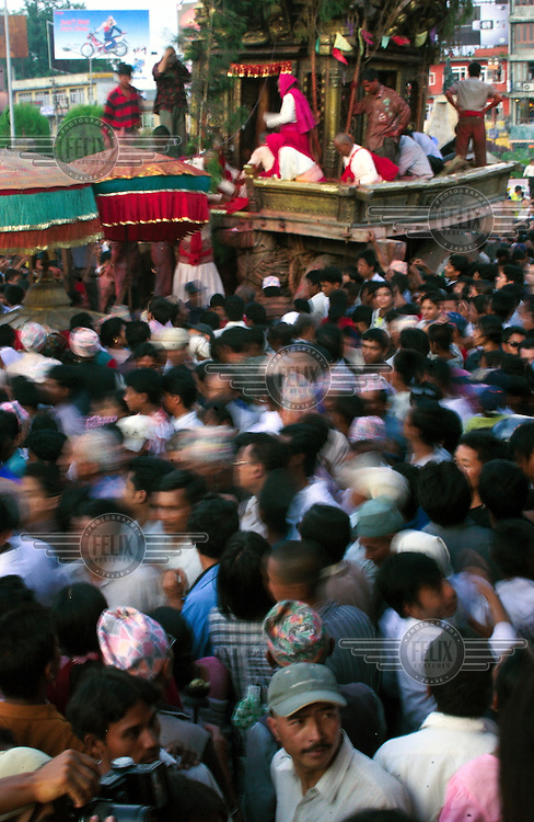 The final day of the annual festival of Rato Machhendranath Rath Jatra. A red faced wooden carved idol of the Red Machhendranath god, (without whose benevolence the rice crops would fail) is transported in a huge chariot and pulled slowly through the streets of Patan over the course of several months.