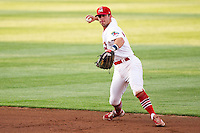 Greg Garcia (7) of the Springfield Cardinals throws to first base during a game against the Arkansas Travelers at Hammons Field on June 12, 2012 in Springfield, Missouri. (David Welker/Four Seam Images).