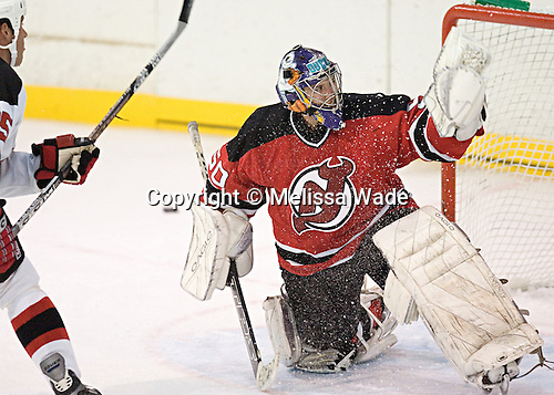 Gregg Naumenko makes a save on Mike Pandolfo. The New Jersey Devils took the ice officially for the first time at their 2006 training camp  on Friday, September 15, 2006 at their South Mountain training facility in West Orange, NJ.