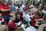 Flip Benham, leader of , Operation Save America encourages young children to shred copies of Suprem Court decision in Roe-vs Wade outside the Mississippi state capital in Jackson Mississippi Tuesday July 18,2006. Benham ripped up copies of Supreme court rulings includinng Roe-vs-Wade and a rainbow flg and planned on burning them all, except the jackson police would not allow a fire to be set on the steps citing a burn ban in the capital. Operation Save America is anti-abortion and plans to protest in jackson for as long as it takes to close the clinic, they are also planning protest at the state capital.(Photo©Suzi Altman)