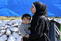 Pictured: A mother with her young child at the refugee camp Tuesday 23 February 2016<br /> Re: Migrants at a refugee camp in the Schisto area of Athens, Greece.