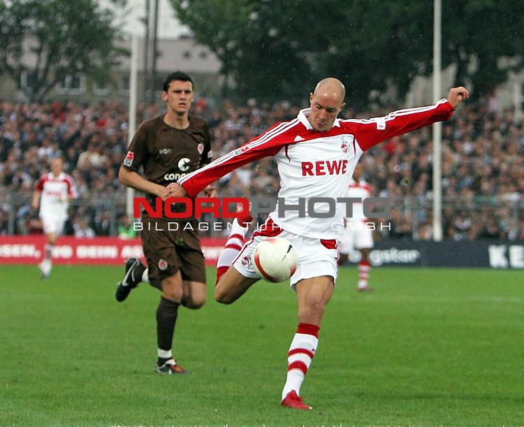 2.Liga 2007/2008  1. Spieltag Hinrunde<br /> FC St.Pauli &ndash; vs. 1.FC Koeln 0:2<br /> <br /> Nemanja Vucicevic (Nr.21, 1.FC Koeln) mit volley Direktabnahme. Ralph Gunesch kommt zu spaet. Neueinkaeufe unter sich.<br /> <br /> <br /> Foto &copy; nph (nordphoto)<br /> <br /> *** Local Caption ***