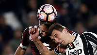 Calcio, Serie A: Torino, Juventus Stadium, 6 maggio 2017. <br /> Torino' Cristian Molinaro (l) in action with Mario Mandzukic  (r) during the Italian Serie A football match between Juventus and Torino at Torino's Juventus stadium, May 6, 2017.<br /> UPDATE IMAGES PRESS/Isabella Bonotto